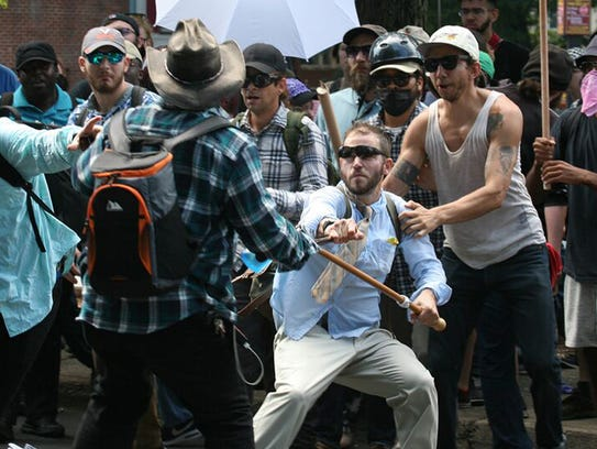 Violence erupts between counter protesters and white