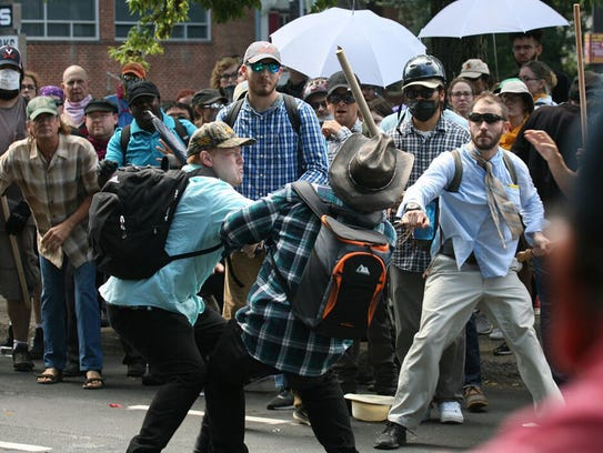 Violence erupts between counter-protesters and white