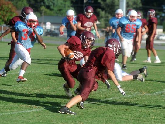 Stuarts Draft running back Brady Ward looks for some