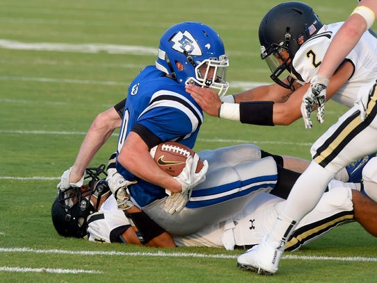 Fort Defiance's Matthew Wonderley is tackled by Buffalo