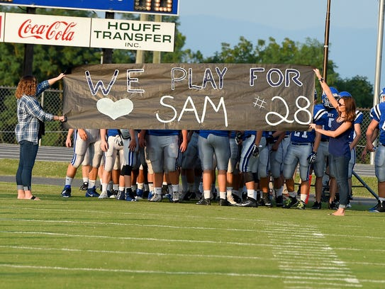 A banner honoring Fort Defiance's Sam Hill is stretched