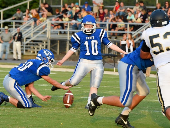 Fort Defiance kicker Sophie Hodge kicks the extra point