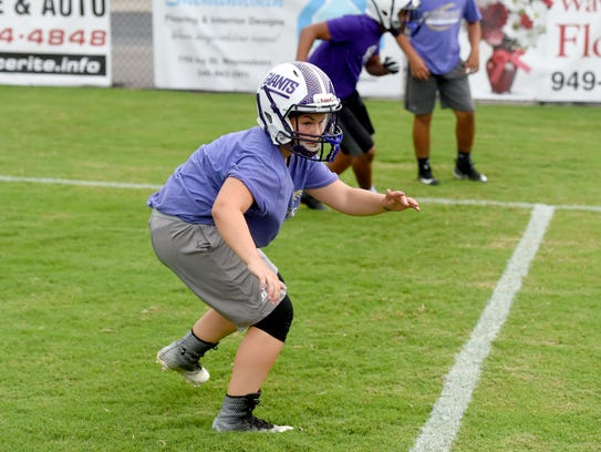 Eight-grader Sophie Sontz-Morrison warms up with the