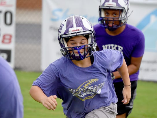 Eight-grader Sophie Sontz-Morrison runs plays with