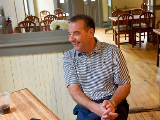 """Owner Peter Harrison talks about Stacks Foods and Catering, a deli restaurant and catering service he opened in the American Hotel alongside the train station in Staunton. """"My favorite thing is the recognition of the joy that people have when they eat really good food,"""" he said."""