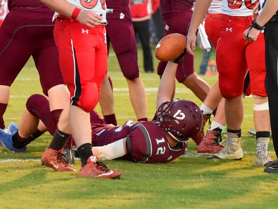 Stuarts Draft's Areian Sanders holds the ball up as