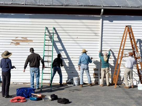 Community members paint the Middlebrook General Store
