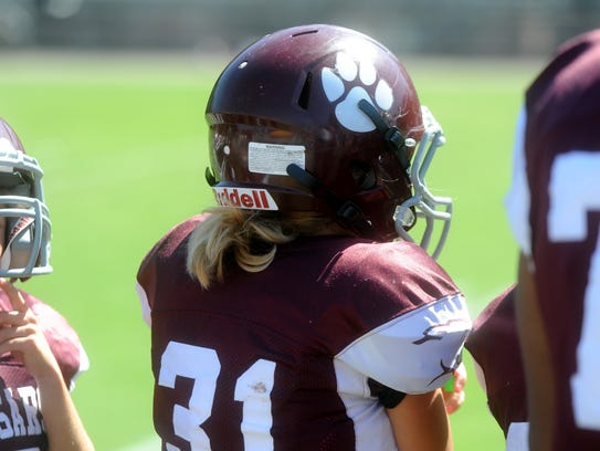 Mackenzie Conner, 10, plays youth football in Stuarts