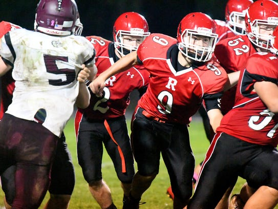 Riverheads quarterback Tyler Smith tries to clear a