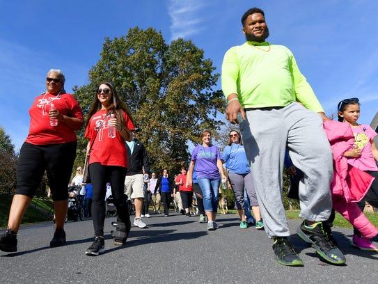 Participants walk three laps together around Gypsy