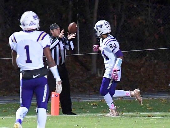 Waynesboro's Nasir Dyer tosses the ball to the referee