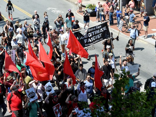 Counter protesters march along Water Street just before