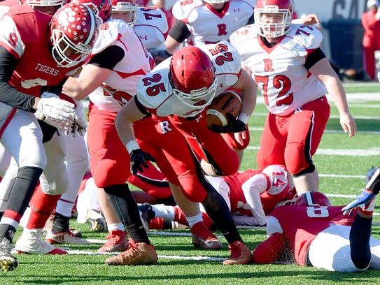 Riverheads' Brett Hostetler breaks free of a tackle