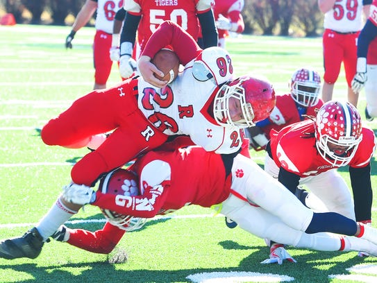 Riverheads' Dalton Jordan is brought down after a gain