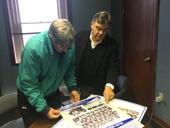 Jim Goodloe, left, and Charlie Bishop look over posters