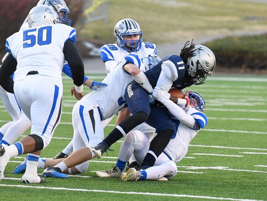 Appomattox County's Omar Bailey is wrapped up and dragged