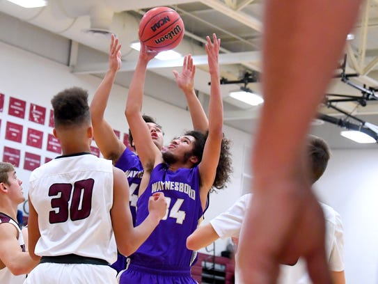 Stuarts Draft's Damien Fisher comes away with the rebound