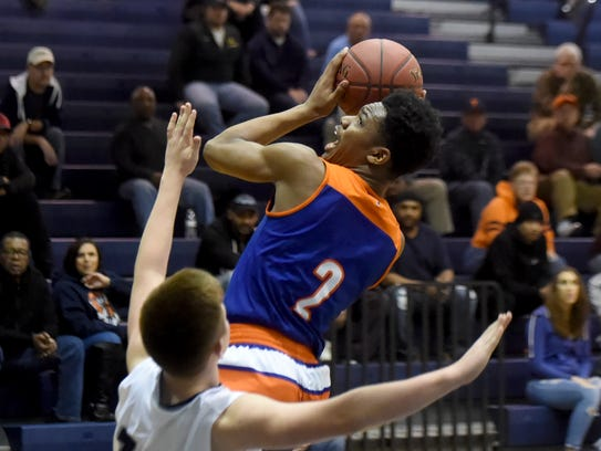 York High's Clovis Gallon Jr. goes up for a shot during