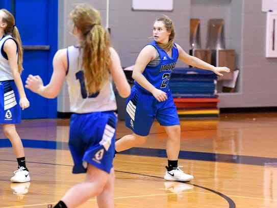 Fort Defiance's Meredith Lloyd practices with the team