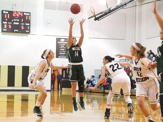 Wilson Memorial's Sam Kershner shoots during a basketball