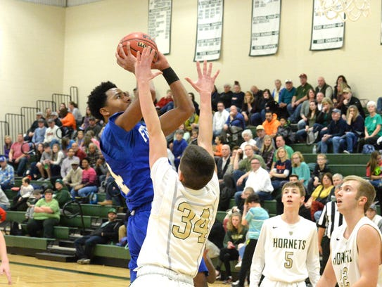 Lee High's Isaiah Elliston drives to the basket against