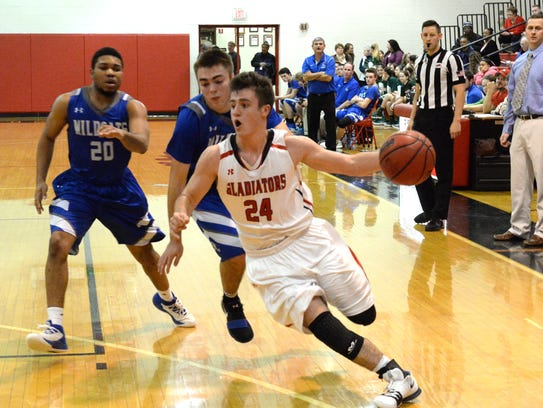 Riverheads' Grant Painter drives to the basket against