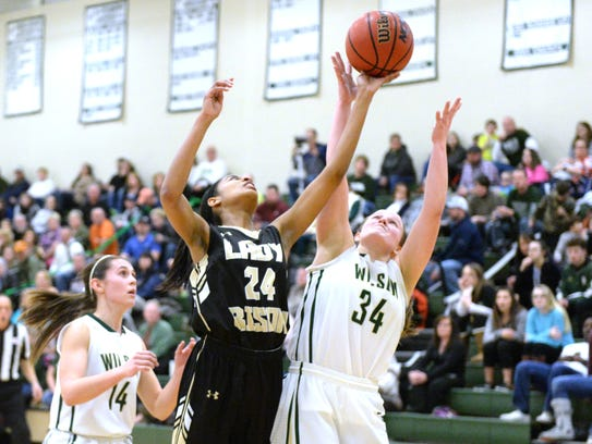 Buffalo Gap's Amaya Lucas (24) battles for a rebound with Wilson Memorial's Cheridan Hatfield (34) Feb. 6.
