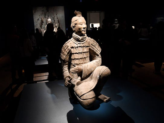 """""""Kneeling Archer"""" is one of 10 life-sized figures from"""