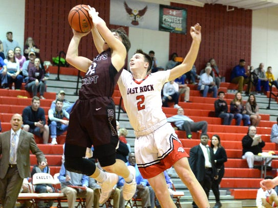 Stuarts Draft's Nick Lasam goes to the basket while