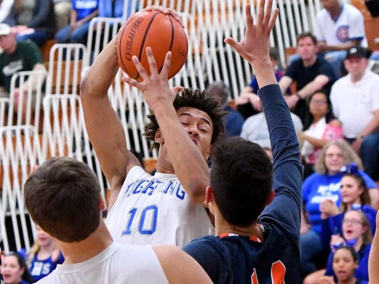 Robert E. Lee's Jarvis Vaughan plucks the rebound out