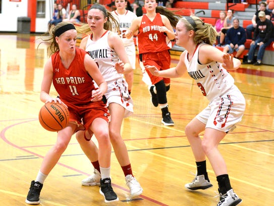 Riverheads' Sara Moore dribbles against a pair of Stonewall