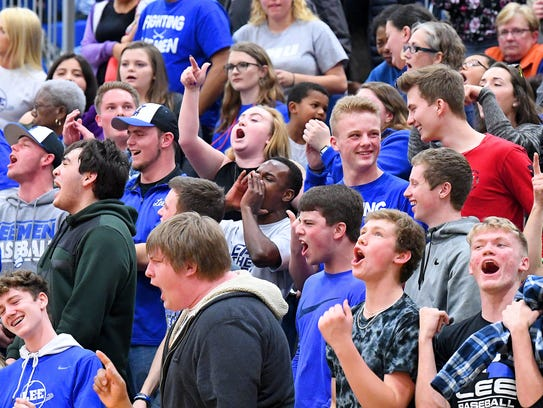 Robert E. Lee fans cheer after another basket for their