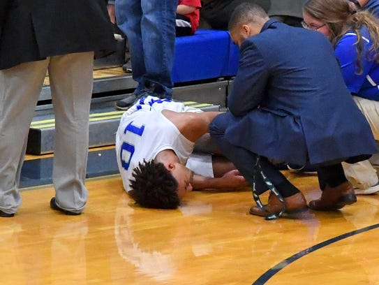 Robert E. Lee's Jarvis Vaughan goes down with an injury