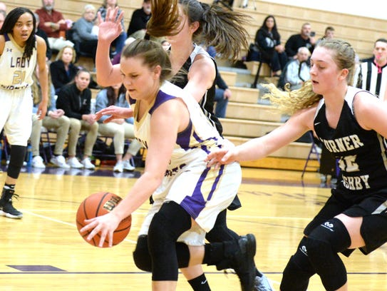 Waynesboro's Sydney Sutton tries to save the ball from