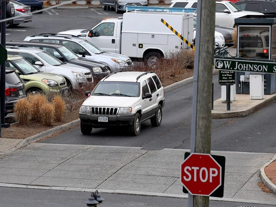 A motorist leaves the Wharf parking lot in Staunton.