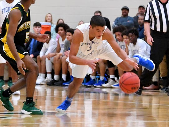Robert E. Lee's Jayden Williams fights to stay on his
