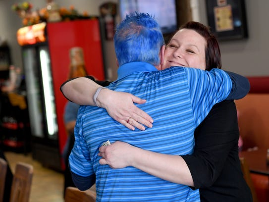Leanne Sherwood embraces her friend Marty Saxberg before she purchases lunch at Sons of Sicily in Shrewsbury on Thursday, March 15, 2018. Saxberg, who works at Giant in Shrewsbury, was diagnosed with colon cancer, and his co-workers set up a fundraiser through the pizza shop to help him with his medical expenses.