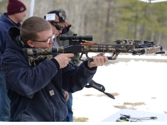 Cameron Stroop, 16, practices the crossbow Saturday