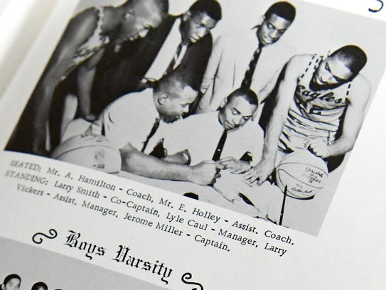 Basketball coaching staff pictured in a 1965 yearbook