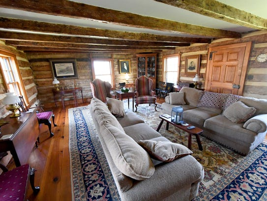 Living room inside the1820s log cabin at Forest Hill