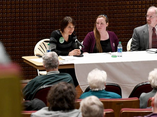 School board candidate Christine Poulson (left) answers