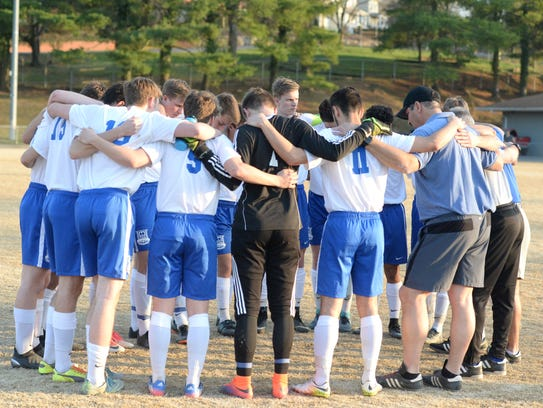 Lee High gathers in a pregame huddle before taking