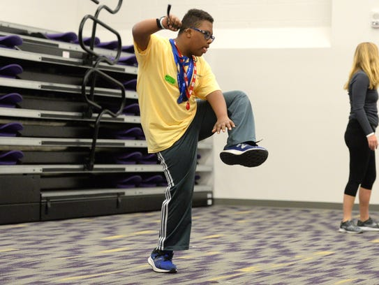 Joshua Parson works on his dance moves at JMU's Overcoming