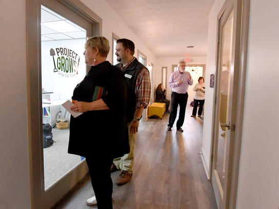 People explore the inside of the 32 North Augusta location