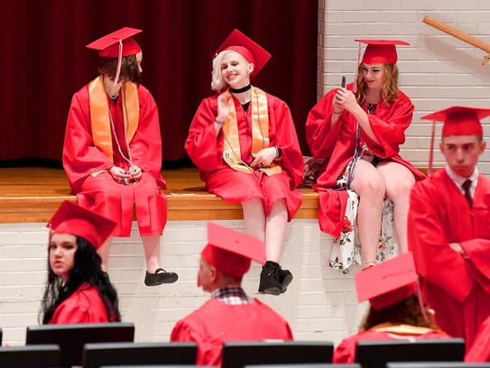 Graduates wait together before the start of commencement