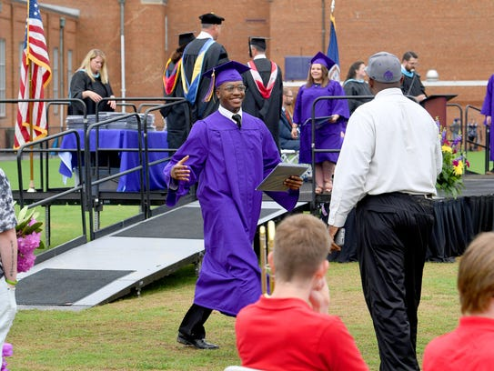 Graduate Opwoche Jones Lyabaya has a smile on his face