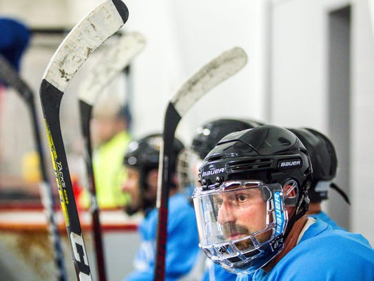 Rob Chinsky sits on the bench during his team's final