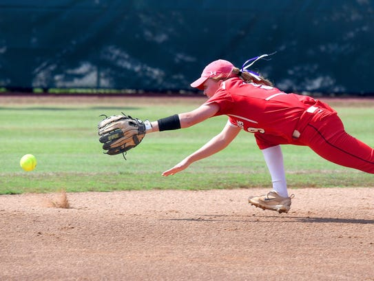 Riverheads' Emma Grubb dives after the ball in the