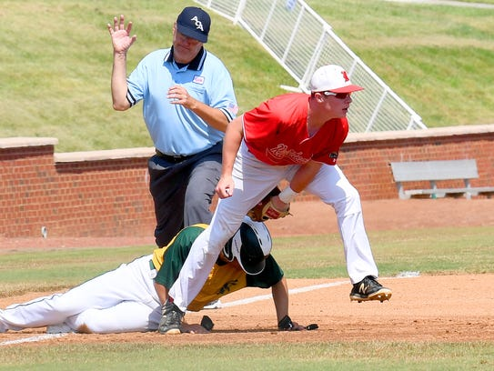 Riverheads' Braeson Fulton tags out Northumberland's