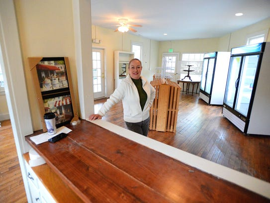Owner Denise Wright stands in the middle of the future